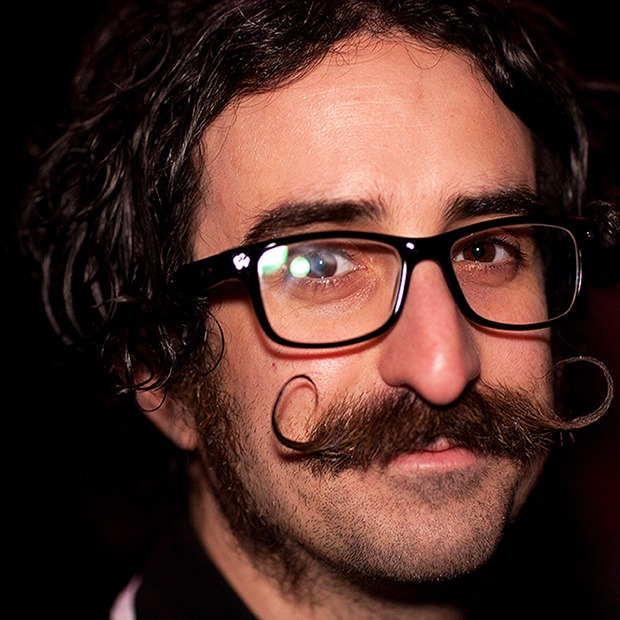 Man with glasses and curly mustache