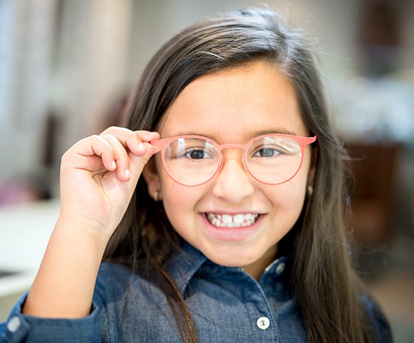 Little Girl trying glasses at the optician