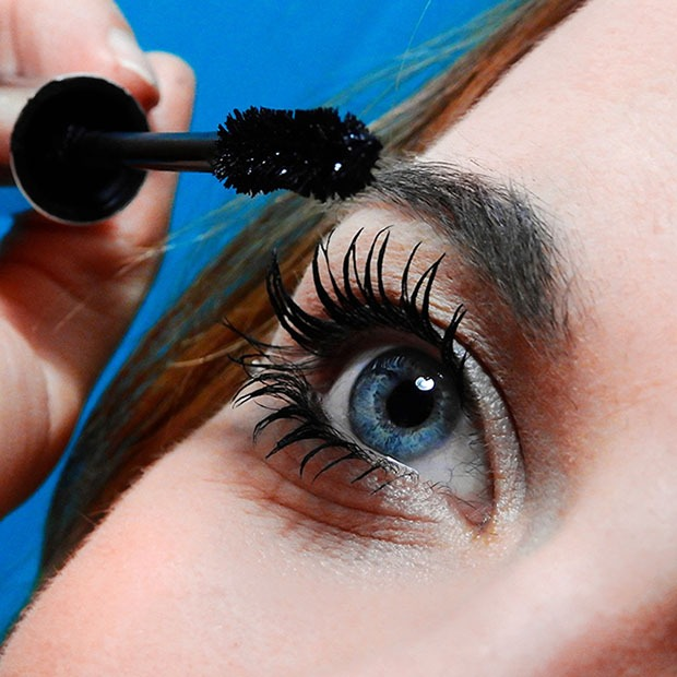 Closeup shot of woman applying mascara