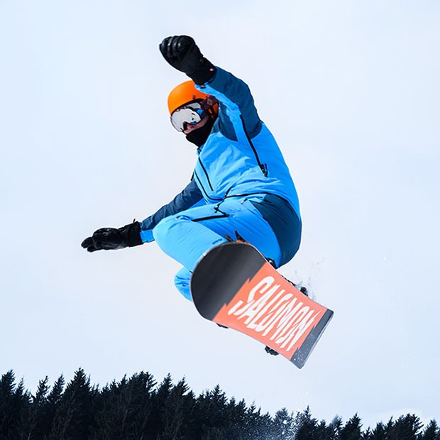 Picture of snowboarder performing a trick in the air