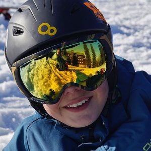 Closeup shot of person in snow gear with their eyes covered
